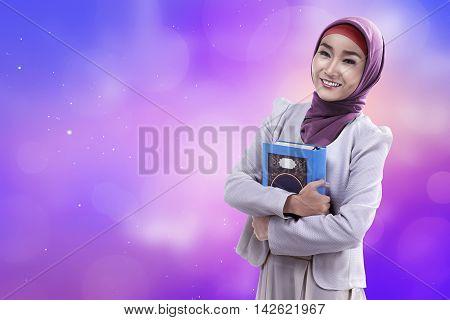 Beautiful Asian Woman Wearing Hijab Holding Koran