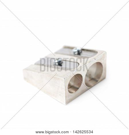 Steel metal pencil sharpener isolated over the white background