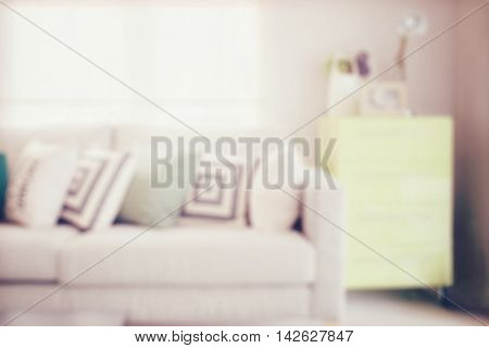 Blur Image Of Cozy Sofa With Geometric Pattern Pillows And Sideb