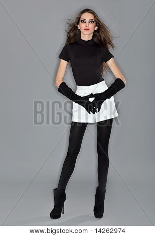 Young Beautiful Woman In Black Combi Dress, White Shorts And Velvet Gloves, Ring Flash Studio Portra