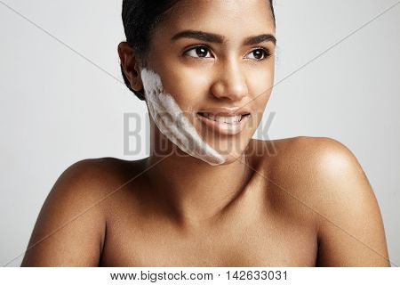 Woman With A Fase Cleansing Foam On The Cheek