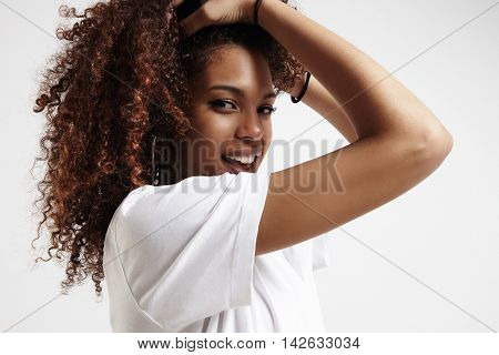 beauty young black woman with curly big hair