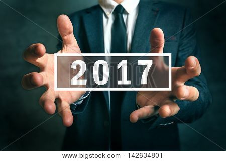 Business opportunities in 2017 businessman making plans for the new year.