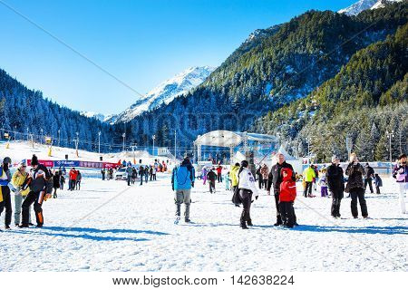 Bansko, Bulgaria - December 12, 2015: Ski resort Bansko, ski slope with people walking and skiing