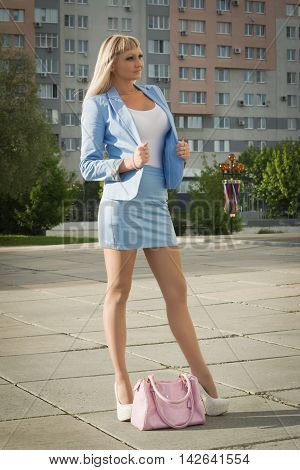 Attractive Business Woman In Suit On A Street