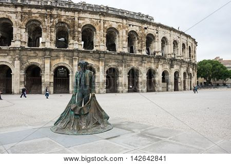 Statue of Toreador and Ancient Roman Theater (Arena) of Nimes south of France
