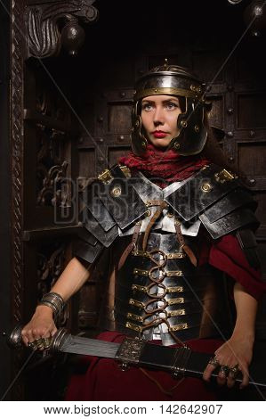 Beautiful Woman In Roman Helmet And Armour