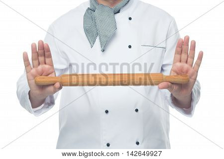 Cook holding a rolling pin in hand