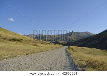road in the foothills of southern Kazakhstan