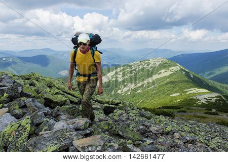Man hiking in the mountains with a backpack