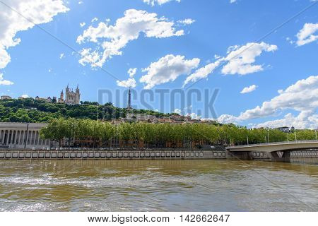 Soane river view with cathedrals Saint-Georges and Fourviere under blue sky white cloud in Lyon France.