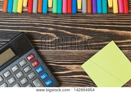 Education Concept. Top View of School and Office Supplies on Wooden Background with Place for your Text
