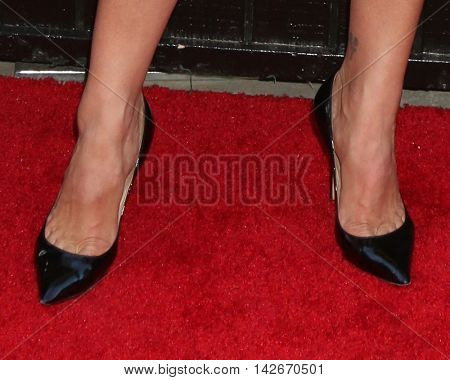 LOS ANGELES - AUG 10:  Heather Tom (shoe detail) at the CBS, CW, Showtime Summer 2016 TCA Party at the Pacific Design Center on August 10, 2016 in West Hollywood, CA