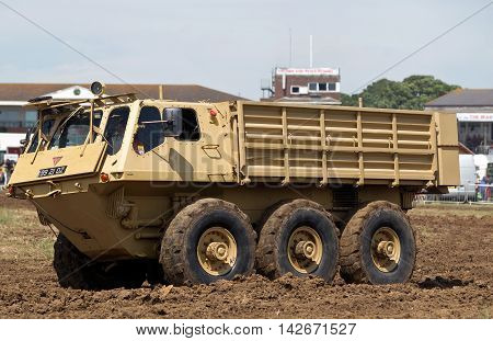 WESTERNHANGER, UK - JULY 19: An ex British army Alvis Stalwart amphibious troop carrier is driven around the main arena for the public to watch at the W&P show on July 19, 2014 in Westernhanger