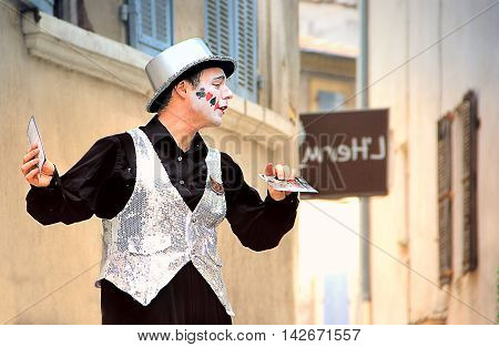 AVIGNON, FRANCE - JULY 19 2014: Actor on stilts advertising his performance during famous theatre festival from July 4 to 27 2014 in Avignon south of France. The Avignon Festival is today one of the most important contemporary performing arts events