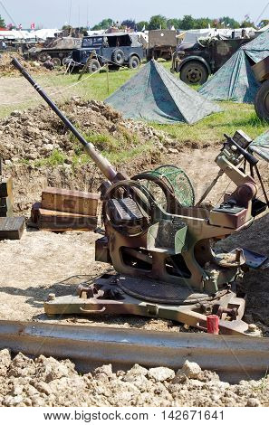 WESTERNHANGER, UK - JULY 18: A vintage WW2 German army anti-aircraft gun is dug into a gun pit as part of a diorama for the public to interact with at the W&P show on July 18, 2014 in Westernhanger