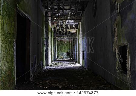 grunge and creepy ruin of abandoned hotel building in Sete Cidades at Sao Miguel Azores island of Portugal in construction decay and obsolete industry crisis concept