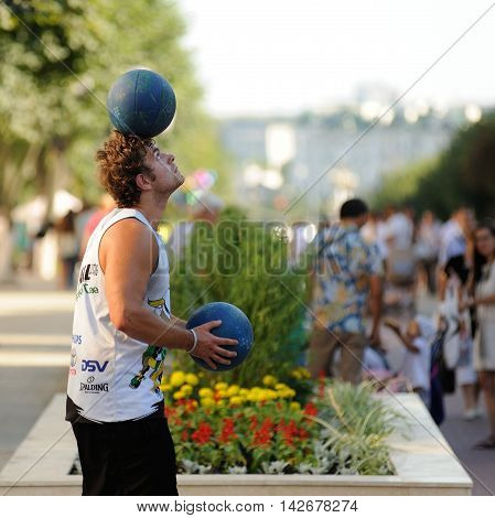 Orel Russia - August 05 2016: Orel city day. Man juggling with balls in the street closeup