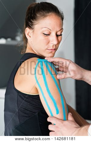 Physical Therapist Using Kinesio Tape