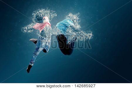 Water dancers jumping. Two water dancers jumping