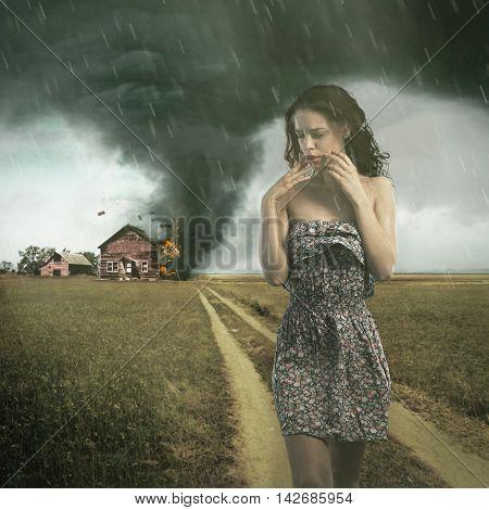 Tornado destroying a woman's house. Insurance concept