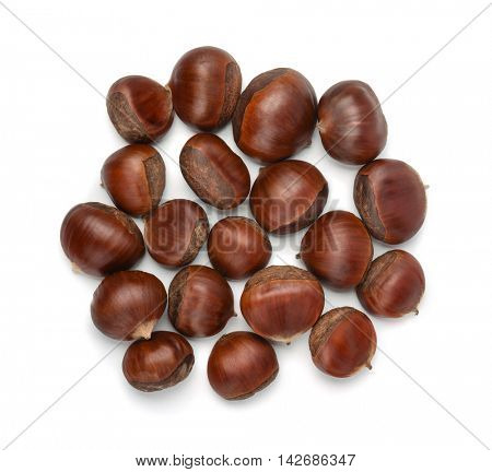 Top view of  whole shelled raw chestnuts isolated on a white