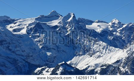 Snow covered Mt Uri Rotstock. High mountain in Central Switzerland. View from Mt Fronalpstock.