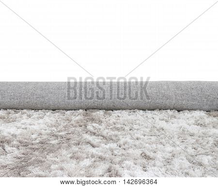 Closeup surface abstract fabric pattern at the roll gray fabric carpet at the floor of house texture background isolated on white background