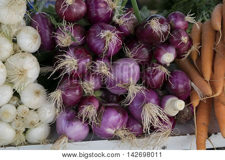 Red onions sold as is on a rural market
