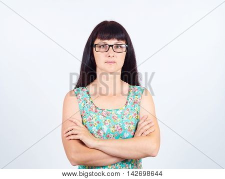 Portrait Of A Serious Young Woman With Glasses