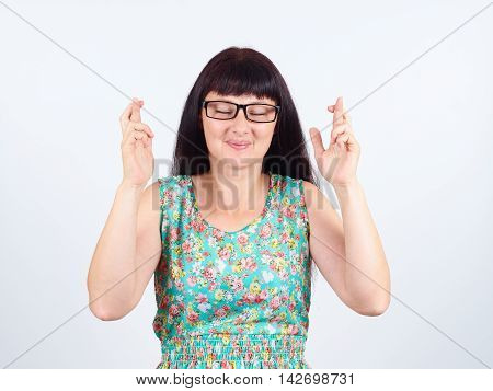 Young Woman With Glasses Crossing Her Fingers, Eyes Closed, Hoping, Asking Best Isolated .