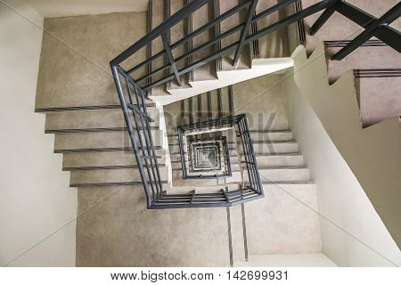 Top view of infinite Spiral Stairway way to success way to escape emergency fire exit stairway.