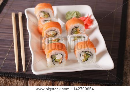Philadelphia Sushi Roll With Salmon Served With Wasabi And Ginger Close-up. Horizontal