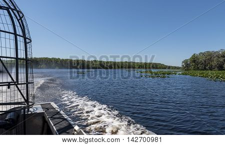 the view behind an air boat, at the wake, on a central Florida lake
