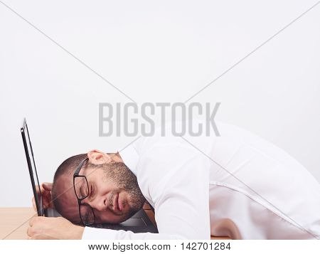 Portrait  Of Tired Businessman Sleeping On His Laptop