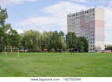 JELENIA GORA POLAND - AUGUST 15 2016: soccer field in front of an industrialized apartment block in Jelenia Gora Poland