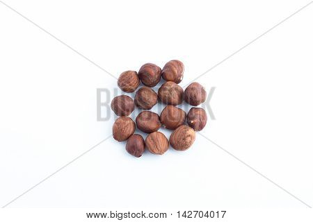 Hazelnuts on a white background. Broun nuts