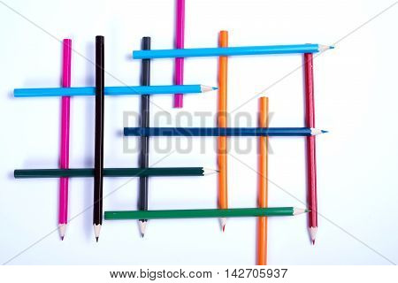 colorful pencils organized in a geometric form on white background