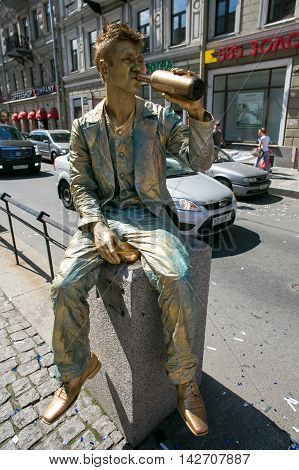 St. PETERSBURG RUSSIA - JUL 2 2016: Street actor (living statue) in the image of Semyon Marmeladov from famous novel by Fyodor Dostoevsky