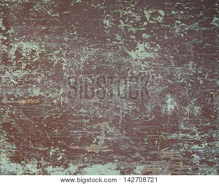 Old wooden table board with shabby and cracked color paint