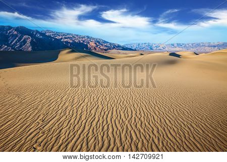 Early morning  in a picturesque part of Death Valley, USA. Mesquite Flat Sand Dunes. Small ripples on sand dunes