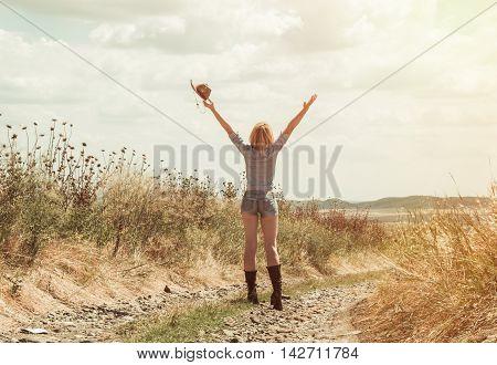 pretty woman in cowboy hat outdoors in farm