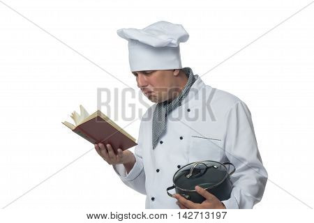 chef with pot in his hand a recipe book looks