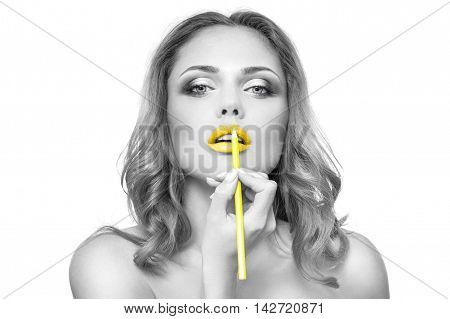 Part of attractive woman's face with fashion yelow lips makeup. Make-up artist apply lipstick