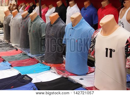 17TH JULY 2016, CALIS,TURKEY: Fake shirts  for sale on a stall in a local market in calis, Turkey, 17th july 2016