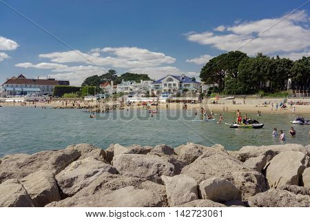 Sandbanks/UK. 14th August 2016. Day trippers enjoy the warm sunshine and crystal clear waters of Sandbanks beach on the UK's south coast.