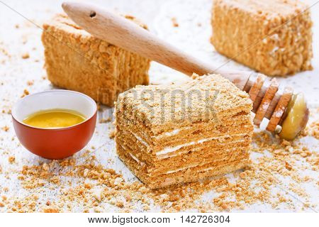 Sweet homemade honey cake on a white table selective focus