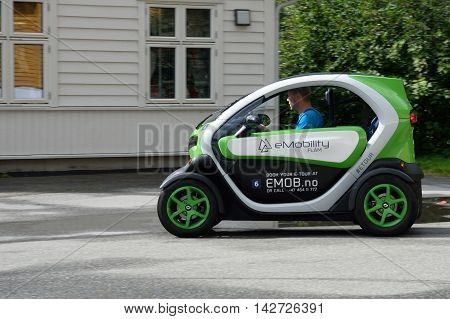 Flam Norway - July 30 2016: Man driving very small eco car on tour in Flam