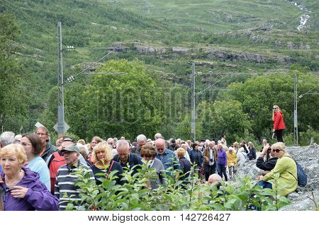 Flam Norway - July 30 2016: Large cruise ship group on railway tour with guide on rock