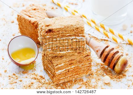 Sweet honey-cake for dessert on white wooden table selective focus